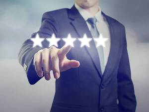 Man in a suit touching a floating star rating